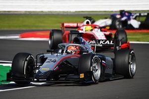 Nikita Mazepin, Hitech Grand Prix, leads Mick Schumacher, Prema Racing