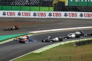 Bruno Senna, Williams FW34, Sebastian Vettel, Red Bull Racing RB8 and Sergio Perez, Sauber C31 collide at the start of the race
