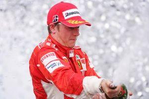 Kimi Raikkonen, Ferrari F2007, celebrates on the podium
