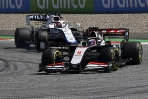 Romain Grosjean, Haas VF-20, leads George Russell, Williams FW43