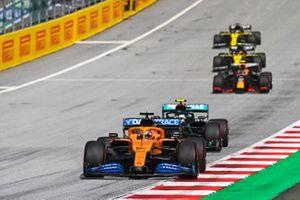 Carlos Sainz Jr., McLaren MCL35, leads Valtteri Bottas, Mercedes F1 W11 EQ Performance