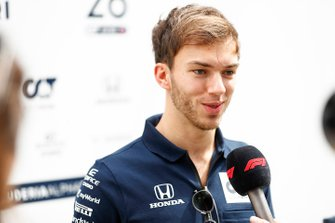 Pierre Gasly, AlphaTauri, talks to the press
