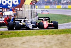 Elio de Angelis, Lotus 97T Renault, leads Stefan Johansson, Ferrari 156/85