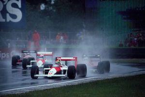 Ayrton Senna, McLaren MP4-4 Honda, leads Gerhard Berger, Ferrari F1/87-88C and Alain Prost, McLaren MP4-4 Honda