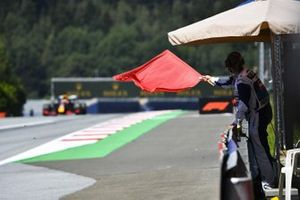 Marshall waves Red Flag as Max Verstappen, Red Bull Racing RB16 passes