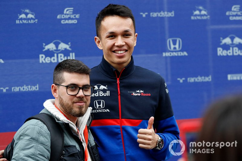 Alex Albon, Scuderia Toro Rosso poses for a photo with a fan