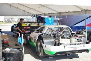 Crew members work on the #44 TA Chevrolet Corvette driven by AJ Henricksen of ECC Motorsports