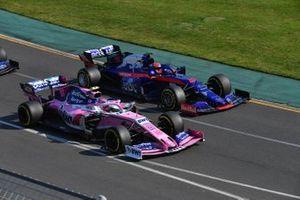 Lance Stroll, Racing Point RP19, battles with Daniil Kvyat, Toro Rosso STR14, at the start
