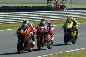 Casey Stoner, KTM; Roberto Locatelli, Aprilia; Andrea Dovizioso, Honda