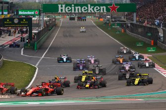 Charles Leclerc, Ferrari SF90, leads Sebastian Vettel, Ferrari SF90, Max Verstappen, Red Bull Racing RB15, Pierre Gasly, Red Bull Racing RB15, Nico Hulkenberg, Renault F1 Team R.S. 19, Daniel Ricciardo, Renault F1 Team R.S.19, Romain Grosjean, Haas F1 Team VF-19, and the remainder of the field at the start of the race