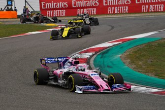 Sergio Perez, Racing Point RP19, leads Nico Hulkenberg, Renault F1 Team R.S. 19, and Romain Grosjean, Haas F1 Team VF-19