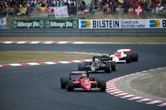 Michele Alboreto, Ferrari 156/85, leads Elio de Angelis, Lotus 97T Renault and Alain Prost, McLaren MP4-2B TAG