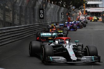 Valtteri Bottas, Mercedes AMG W10, leads Pierre Gasly, Red Bull Racing RB15, Carlos Sainz Jr., McLaren MCL34, and Daniil Kvyat, Toro Rosso STR14