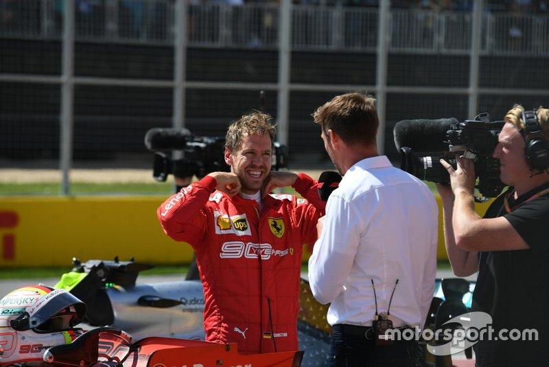 Sebastian Vettel, Ferrari, talks to Jenson Button, Sky Sports F1, after securing pole