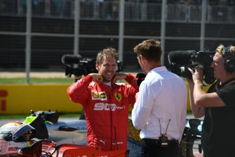 Sebastian Vettel, Ferrari, talks to Jenson Button, Sky Sports F1, after securing pole