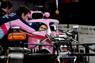 Sergio Perez, Racing Point RP19 sits in the cockpit of his car with a medal above