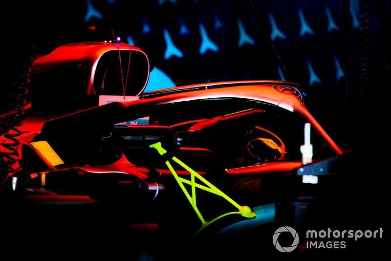 Mercedes AMG F1 W10 in the garage at night