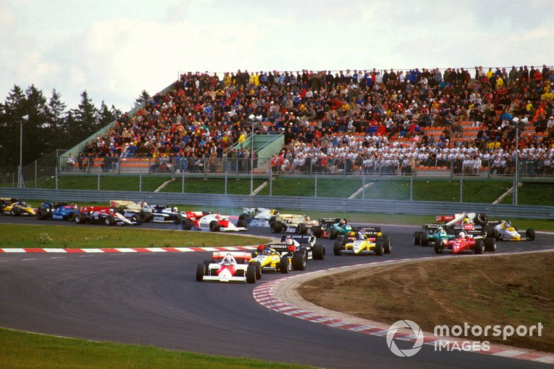 Alain Prost, McLaren MP4\2 TAG Porsche, leads Patrick Tambay, Renault RE50, Nelson Piquet, Brabham BT53 BMW and Derek Warwick, Renault RE50 at the start. Others lock up coming into the Castrol-S as Ayrton Senna, Toleman TG184 Hart, crashes into Keke Rosberg, Williams FW09B Honda