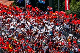 Fans form the Austrian flag colours in a grandstand