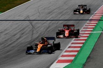 Lando Norris, McLaren MCL34, leads Sebastian Vettel, Ferrari SF90, and Max Verstappen, Red Bull Racing RB15