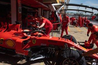 Sebastian Vettel, Ferrari SF90, is returned to the garage