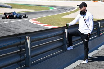 Nikita Mazepin, Mercedes AMG, watches trackside