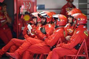 The Ferrari pit crew rest between stops