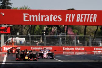 Max Verstappen, Red Bull Racing RB15, leads Sergio Perez, Racing Point RP19, and Charles Leclerc, Ferrari SF90