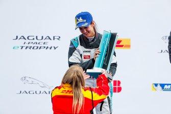 Célia Martin, Viessman Jaguar eTROPHY Team Germany, 2nd position, receives her trophy on the podium
