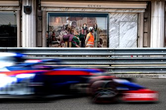 Daniil Kvyat, Toro Rosso STR14, passes a Gucci shop