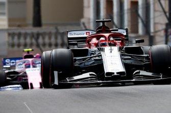 Kimi Raikkonen, Alfa Romeo Racing C38, leads Lance Stroll, Racing Point RP19