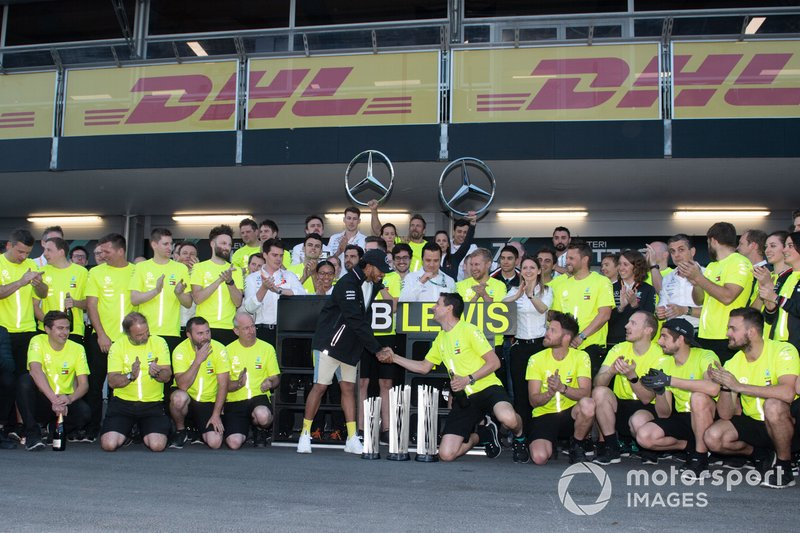Lewis Hamilton, Mercedes AMG F1, 2nd position, Valtteri Bottas, Mercedes AMG F1, 1st position, and the Mercedes team celebrate after the race
