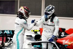 Valtteri Bottas, Mercedes AMG F1, 1st position, is congratulated by Lewis Hamilton, Mercedes AMG F1, 2nd position, in Parc Ferme