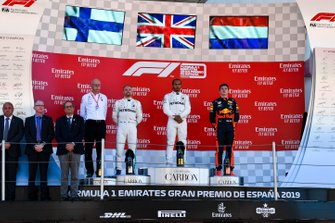 Dr Dieter Zetsche, CEO, Mercedes Benz, Valtteri Bottas, Mercedes AMG F1, 2nd position, Lewis Hamilton, Mercedes AMG F1, 1st position, and Max Verstappen, Red Bull Racing, 3rd position, on the podium