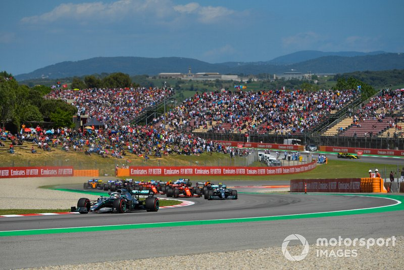 Lewis Hamilton, Mercedes AMG F1 W10, leads Valtteri Bottas, Mercedes AMG W10, Sebastian Vettel, Ferrari SF90, Max Verstappen, Red Bull Racing RB15, and the rest of the field at the start