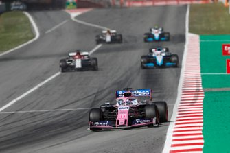 Sergio Perez, Racing Point RP19, leads Kimi Raikkonen, Alfa Romeo Racing C38, and George Russell, Williams Racing FW42