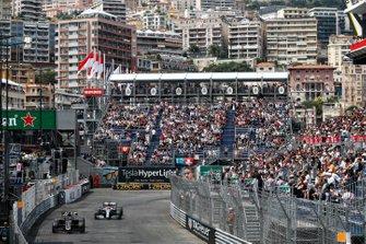 Romain Grosjean, Haas F1 Team VF-19, leads Lewis Hamilton, Mercedes AMG F1 W10