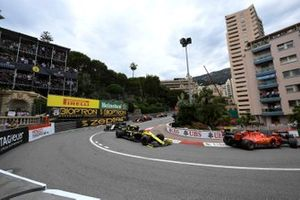 Sebastian Vettel, Ferrari SF90, leads Daniel Ricciardo, Renault R.S.19, and Kevin Magnussen, Haas F1 Team VF-19