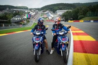 Pierre Gasly, Toro Rosso, sits astride a scooter at Eau Rouge
