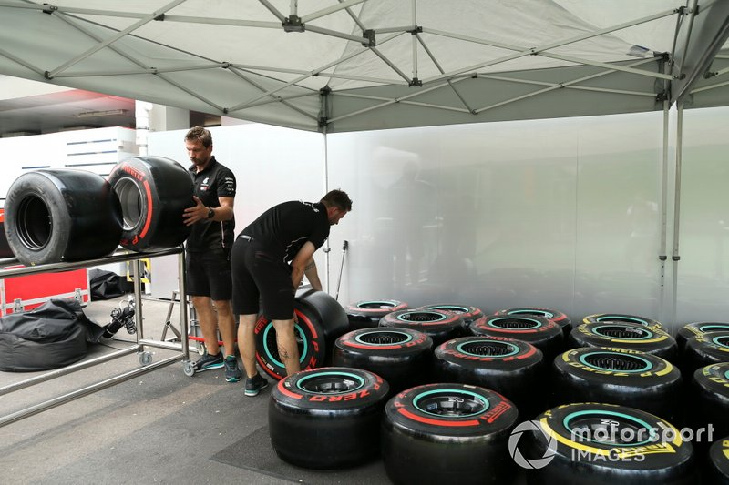 AMG Mercedes F1 personnel work on Pirelli tyres