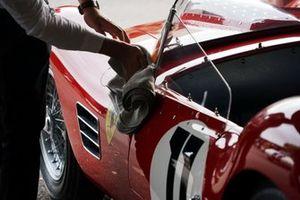A mechanic polishes a Ferrari 250 TR59/60