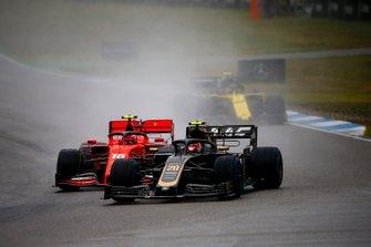 Kevin Magnussen, Haas F1 Team VF-19, leads Charles Leclerc, Ferrari SF90