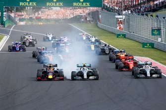 Max Verstappen, Red Bull Racing RB15 leads Valtteri Bottas, Mercedes AMG W10, Lewis Hamilton, Mercedes AMG F1 W10 and Sebastian Vettel, Ferrari SF90 at the start of the race