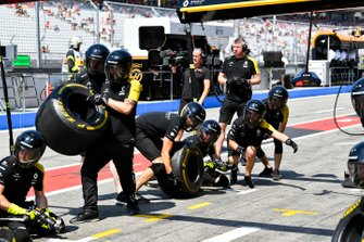 The Renault pit crew prepare for a stop during practice