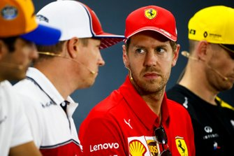 Sebastian Vettel, Ferrari and Kimi Raikkonen, Alfa Romeo Racing talk in the Press Conference