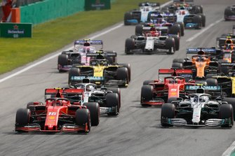 Charles Leclerc, Ferrari SF90, leads Valtteri Bottas, Mercedes AMG W10, Lewis Hamilton, Mercedes AMG F1 W10, Sebastian Vettel, Ferrari SF90, Nico Hulkenberg, Renault F1 Team R.S. 19, Daniel Ricciardo, Renault F1 Team R.S.19, and the rest of the field at the start