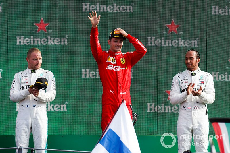 Valtteri Bottas, Mercedes AMG F1, 2nd position, Charles Leclerc, Ferrari, 1st position, and Lewis Hamilton, Mercedes AMG F1, 3rd position, on the podium