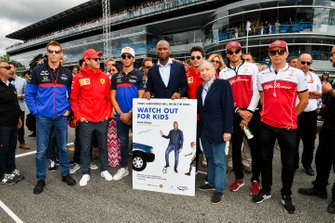 Daniil Kvyat, Toro Rosso, Sebastian Vettel, Ferrari, Pierre Gasly, Toro Rosso, Footballer Didier Drogba, Charles Leclerc, Ferrari, Jean Todt, President, FIA, Antonio Giovinazzi, Alfa Romeo Racing, and Kimi Raikkonen, Alfa Romeo Racing, support a safe driving campaign