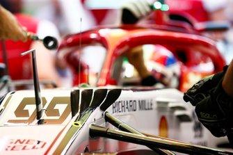 Mechanics work in the Antonio Giovinazzi Alfa Romeo Racing C38