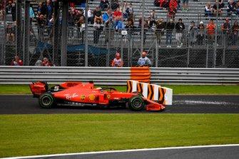 Sebastian Vettel, Ferrari SF90, takes to a run-off area